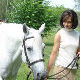 Jackie Kennedy pasea con su caballo