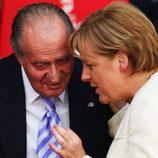 Juan Carlos I y Angela Merkel