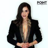 Roko, con vestido negro y ribetes dorados para la portada de Point Magazine