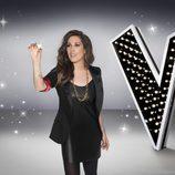 Malú cogiendo una estrella en una foto promocional de 'La Voz 5'