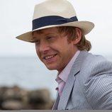Rupert Grint sonriente en este fotograma de 'Snatch'