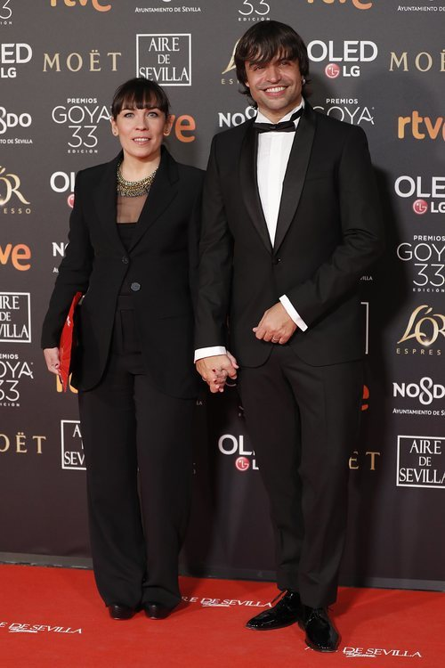 Manu Guix y su mujer en la alfombra roja de los Premios Goya 2019